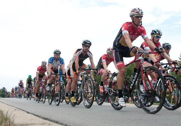The final race of the first annual Prairie State Cycling Series Criterium crosses the Prairie Street bridge in St. Charles Sunday afternoon.