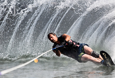 Josh Peckler - Jpeckler@shawmedia.com Ed Figel of Crystal Lake nearly falls as he goes around a buoy while slalom water skiing at Crystal Lake Sunday, July 15, 2004. The Crystal Lake Water Ski Association hosted a slalom qualifier water ski tournament to provide a level playing field of fun competition for members.