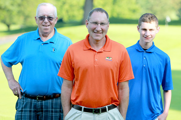 Eliot Kaufman (center) with his father-in-law Tom Sweet and his son, Jake, 16, at Pottawatomie Golf Course in St. Charles. Kaufman, who qualified for the championship flight of the St. Charles Men's Tournament, was turned on to Pottawatomie by Sweet, 73, who has played at the course regularly for 52 years.