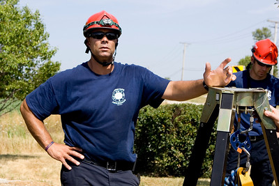 Mike Greene - mgreene@shawmedia.com Woodstock Fire Department TRT Team Leader DeAngelo Cooke speaks with the group following a confined space training hosted by Woodstock Fire Resuce at a water booster station near Centegra Hospital Wednesday, July 18, 2012 in Woodstock. The event, which drew participants from five stations and two MABAS divisions, simulated a confined space rescue in an area no bigger than a bedroom.