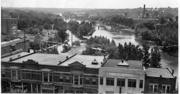 The Fox River is shown flowing through downtown St. Charles in this undated photo from the St. Charles Heritage Center.