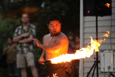 Mike Greene - mgreene@shawmedia.com A fire dancer with The Barefoot Hawaiian performs for a crowd Tuesday, July 31, 2012 at Indian Trail Beach in Lake in the Hills. The event, hosted by the Village of Lake in the Hills, included a mix of dynamic dances, music, and vibrant costumes as well as a fire dancer.
