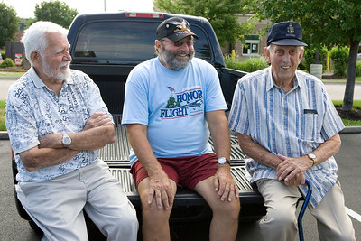 Mike Greene - mgreene@shawmedia.com WWII Navy Veterans Jim Donaldson (left), of Zion, and Fred Simonsen (right), of Crystal Lake, speak with Marine Vietnam Veteran Bill Garand, of Belvidere, before the Honor Flight hosted by the Veterans Network Committee of Northern Illinois Friday, July 27, 2012 at Fifth Third Bank in Cary. Six WWII veterans of McHenry County as well as other county's are taking the three day trip Washington D.C. to see the WWII Memorial and participate in other activities.
