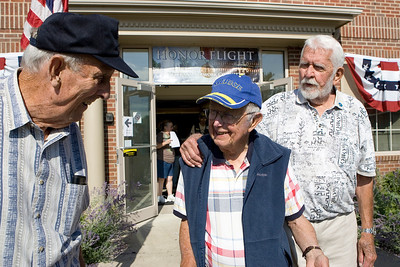 Mike Greene - mgreene@shawmedia.com WWII Veterans Fred Simonsen, of Crystal Lake, Roger Benson, of Highland Park, and Jim Donaldson, of Zion, speak before heading out for the Honor Flight hosted by the Veterans Network Committee of Northern Illinois Friday, July 27, 2012 at Fifth Third Bank in Cary. Six WWII veterans of McHenry County as well as other county's are taking the three day trip Washington D.C. to see the WWII Memorial and participate in other activities.