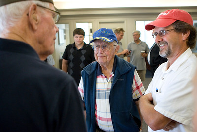 Mike Greene - mgreene@shawmedia.com WWII Army Veteran Roger Benson (center), of Highland Park, and his sone Daniel listen as WWII Army Veteran Warren Sweeney, of Trout Valley, speaks before the Honor Flight hosted by the Veterans Network Committee of Northern Illinois Friday, July 27, 2012 at Fifth Third Bank in Cary. Six WWII veterans of McHenry County as well as other county's are taking the three day trip Washington D.C. to see the WWII Memorial and participate in other activities.