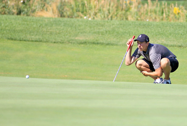 Nathan Podraza lines up his putt during the Illinois Junior Golf Association Tournament at Mill Creek Golf Course in Geneva Wednesday morning.