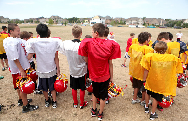 Middle School players gather before a session of the Junior Bulldog Football Camp at Prairie Path Park in Batavia Thursday morning.