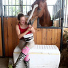 Vanessa Raisanen, 17, of St. Charles laughs as her horse, Romeo, tickles her with his nose as she feeds him treats during the second day of the 2012 Kane County Fair.