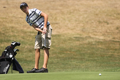 Mike Greene - mgreene@shawmedia.com Hunter Simonini watches his putt roll towards the cup during the McHenry County Junior Golf Association's Cary Open Friday, July 20, 2012 in Cary. Simonini shot a 81 for the round and added 50 points to his overall score in the junior division remaining in the lead with 635 points.