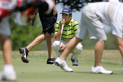 Mike Greene - mgreene@shawmedia.com Daniel Deprey focuses on the green as players pass by during a five-way playoff in the senior division at the McHenry County Junior Golf Association's Cary Open Friday, July 20, 2012 in Cary. Deprey won the playoff after shooting a 78 in the round.