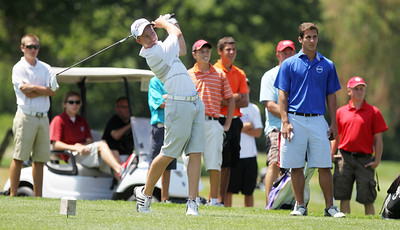 Mike Greene - mgreene@shawmedia.com Players and officials watch as Peter Kalamaras tees off during a five-way playoff in the senior division at the McHenry County Junior Golf Association's Cary Open Friday, July 20, 2012 in Cary. Kalamaras shot a 78 in the round.