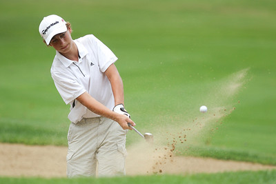 Mike Greene - mgreene@shawmedia.com Remington Reid hits out of a bunker during the McHenry County Junior Golf Association's McHenry Open Monday, July 23, 2012 at the McHenry Country Club in McHenry.