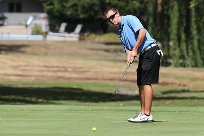 Mike Greene - mgreene@shawmedia.com Tyler Hamid watches his putt approach the hole during the McHenry County Junior Golf Association's McHenry Open Monday, July 23, 2012 at the McHenry Country Club in McHenry. Hamid shot a 84 for the open, earning him a tie for sixth place in the Boys Senior Division.