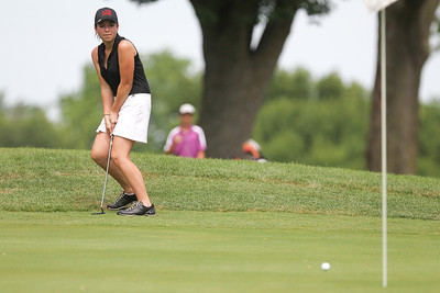Mike Greene - mgreene@shawmedia.com Ann Bandolik watches her putt approach the hole on the 18th during the McHenry County Junior Golf Association's McHenry Open Monday, July 23, 2012 at the McHenry Country Club in McHenry. Bandolik shott a 45 for the open, earning her a tie for second place in the Girls Senior Division.