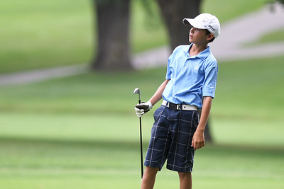 Mike Greene - mgreene@shawmedia.com Ethan Farnam watches his ball fly after an approach shot during the McHenry County Junior Golf Association's McHenry Open Monday, July 23, 2012 at the McHenry Country Club in McHenry. Farnam shot a 76 for the open, earning him first place in the Boys Junior Division.