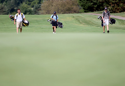 Sarah Nader - snader@shawmedia.com Brandon Dahl (left), 14, of Lake in the Hills, Ben Harvel, 15, of Crystal Lake and Hunter Simonini. 15. of Marengo walk to the ninth hole during the McHenry County Junior Golf Association's Prairie Isle Open in Prairie Grove on Wednesday, July 25, 2012.