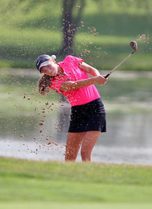Sarah Nader - snader@shawmedia.com Bailey Bostler, 16, of Lake in the Hills hits out of a bunker on the 10th hole during the McHenry County Junior Golf Association's Prairie Isle Open in Prairie Grove on Wednesday, July 25, 2012.