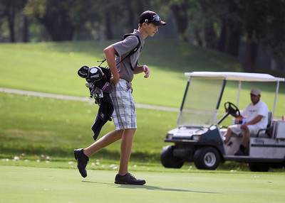 Sarah Nader - snader@shawmedia.com Hunter Simonini, 15, of Marengo walks to the next hole during the McHenry County Junior Golf Association's Prairie Isle Open in Prairie Grove on Wednesday, July 25, 2012.