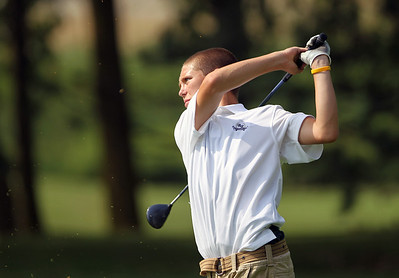 Sarah Nader - snader@shawmedia.com Brandon Dahl, 14, of Lake in the Hills watches his shot during the McHenry County Junior Golf Association's Prairie Isle Open in Prairie Grove on Wednesday, July 25, 2012.
