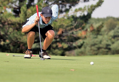 Sarah Nader - snader@shawmedia.com Ben Harvel, 15, of Crystal Lake lines up his putt  during the McHenry County Junior Golf Association's Prairie Isle Open in Prairie Grove on Wednesday, July 25, 2012.