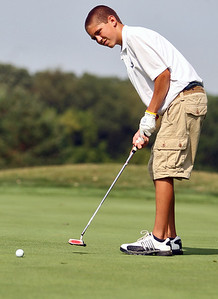 Sarah Nader - snader@shawmedia.com Brandon Dahl, 14, of Lake in the Hills watched his putt approach the eight hole during the McHenry County Junior Golf Association's Prairie Isle Open in Prairie Grove on Wednesday, July 25, 2012.