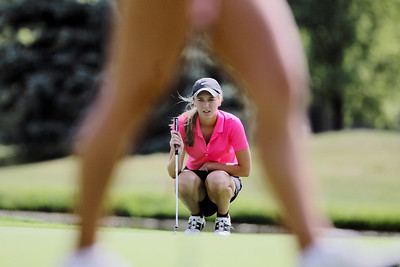 Sarah Nader - snader@shawmedia.com Bailey Bostler, 16, of Lake in the Hills lines up her putt during the McHenry County Junior Golf Association's Prairie Isle Open in Prairie Grove on Wednesday, July 25, 2012.