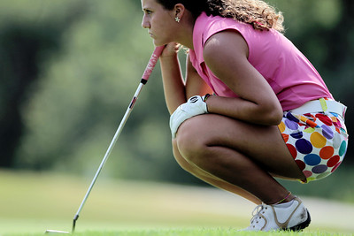 Sarah Nader - snader@shawmedia.com Brianna Digrazia, 16, of Crystal Lake lines up her putt during the McHenry County Junior Golf Association's Prairie Isle Open in Prairie Grove on Wednesday, July 25, 2012.
