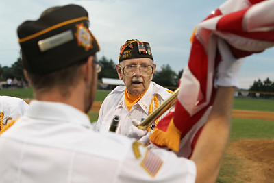 Mike Greene - mgreene@shawmedia.com Fredrick Noble, a WWII veteran from the 95th division, dismantles an American flag following a MCYSA/USSSA 15U Summer International Championship tribute to Armed Forces Sunday, July 29, 2012 at Lippold Park in Crystal Lake. Active and veteran armed forces members were honored before the start of featured games which were umpired exclusively by armed forces veterans.