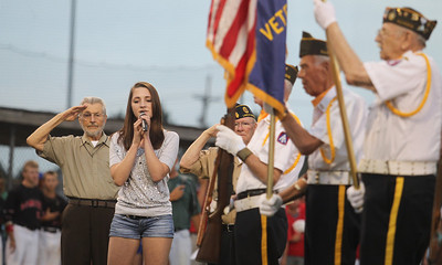 Mike Greene - mgreene@shawmedia.com Melissa Drzal sings the national anthem during a MCYSA/USSSA 15U Summer International Championship tribute to Armed Forces Sunday, July 29, 2012 at Lippold Park in Crystal Lake. Active and veteran armed forces members were honored before the start of featured games which were umpired exclusively by armed forces veterans.