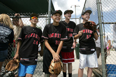 Mike Greene - mgreene@shawmedia.com Crystal Lake Bombers' 15 year-olds Jeremy Gregory, Owen Siddons, Anthony Simboli, and Kyle Wolinski laugh while watching teammates compete in the around the horn challenge during the McHenry County Youth Sports Association baseball skills competition Friday, July 27, 2012 at Lippold Park in Crystal Lake. The competition was held in conjunction with the Summer International Championships which runs July 27 - August 5 at various fields in the county.