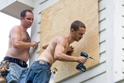 Mike Greene - mgreene@shawmedia.com Casey Kobeszko Jr. and Jonathon Kobeszko work repairing their family home in Lakemoor Thursday, July 19, 2012 after a fire started when the home was hit by lightning.