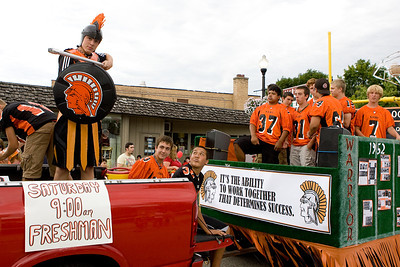 "Mike Greene - mgreene@shawmedia.com Members of the McHenry High School football team participate in the Annual Fiesta Days Parade Sunday, July 22, 2012 in McHenry. This year's theme for the event was ""Chambers 60th Diamond Anniversary"" with floats decorated to suit the theme."