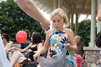 "Mike Greene - mgreene@shawmedia.com Alexis Hetterscheid, 6 of Lake in the Hills, watches as a parade member drops candy into her bag during the Annual Fiesta Days Parade Sunday, July 22, 2012 in McHenry. This year's theme for the event was ""Chambers 60th Diamond Anniversary"" with floats decorated to suit the theme."