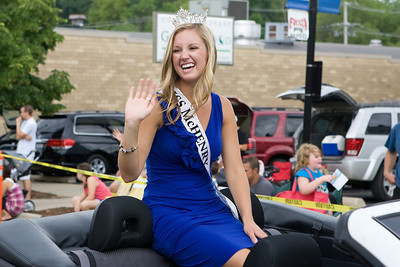 "Mike Greene - mgreene@shawmedia.com Miss McHenry County 2011 Jordyn Butler smiles and waves to onlookers during the Annual Fiesta Days Parade Sunday, July 22, 2012 in McHenry. This year's theme for the event was ""Chambers 60th Diamond Anniversary"" with floats decorated to suit the theme."