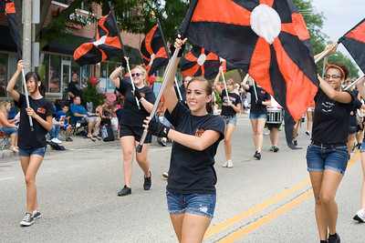 "Mike Greene - mgreene@shawmedia.com Members of the McHenry Community High School Marching Band perform during the Annual Fiesta Days Parade Sunday, July 22, 2012 in McHenry. This year's theme for the event was ""Chambers 60th Diamond Anniversary"" with floats decorated to suit the theme."