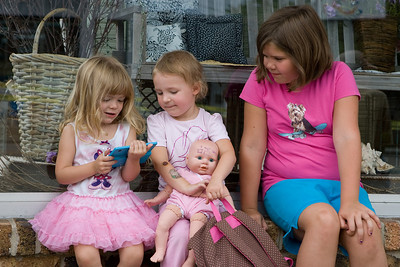 "Mike Greene - mgreene@shawmedia.com McHenry residents Casey Dougherty (left), 3, Kylies Hatter, 3, and Morgan Dougherty play a game while waiting for the Annual Fiesta Days Parade Sunday, July 22, 2012 in McHenry. This year's theme for the event was ""Chambers 60th Diamond Anniversary"" with floats decorated to suit the theme."