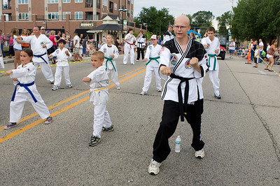 "Mike Greene - mgreene@shawmedia.com Members of the McHenry Flying Dragons perform during the Annual Fiesta Days Parade Sunday, July 22, 2012 in McHenry. This year's theme for the event was ""Chambers 60th Diamond Anniversary"" with floats decorated to suit the theme."