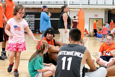 Mike Greene - mgreene@shawmedia.com Angelica Pesavento, 7, plays Duck, Duck, Goose with a group during the third Annual Sports Day with GiGi's Playhouse Saturday, July 14, 2012 at McHenry East High School in McHenry. Members of the MHS football team were paired with special needs children and family members as they participated in various athletic activities.