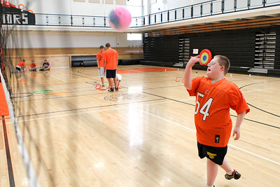 Mike Greene - mgreene@shawmedia.com Brandon Hagy, 12, hits a ball over the net during the third Annual Sports Day with GiGi's Playhouse Saturday, July 14, 2012 at McHenry East High School in McHenry. Members of the MHS football team were paired with special needs children and family members as they participated in various athletic activities.