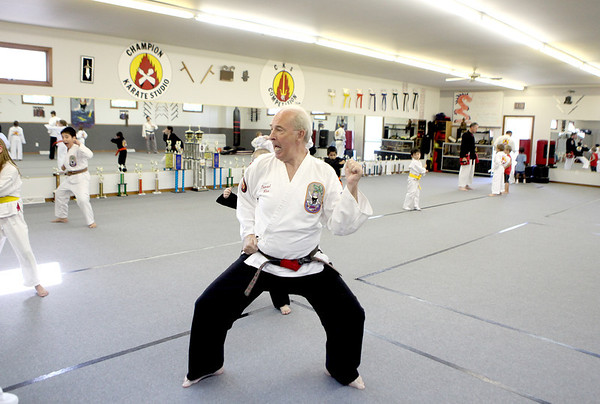 Grandmaster Ron Troutman trains his class at Rocky's Dojo and Gym in Sugar Grove Tuesday evening. Troutman opened the gym over 25 years ago.