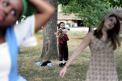 "Sarah Nader - snader@shawmedia.com Matt Fraser (center) of Crystal Lake warms up with the cast before their performance of ""The Merry Wives of Windsor"" at Shakespear in the Park presented by the Riverview Theatre Company at Veteran's Memorial Park in McHenry on Wednesday, July 18, 2012."