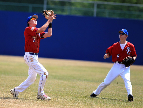 St. Charles American Legion Post 342 player Jordan Hayes (7) makes a catch as teammate Collin Peterson (5) looks on during their second game of a doubleheader against the Chicago Jacks at Judson College in Elgin Friday.