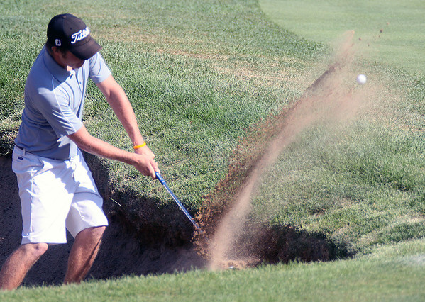 Jeff Krage – For the Kane County Chronicle<br /> Noah Muehlfelt hits a shot out of the bunker onto the first green during Saturday's qualifying round of the St. Charles Men's Golf Tournament at Pottawatomie Golf Course.<br /> St. Charles 7/28/12