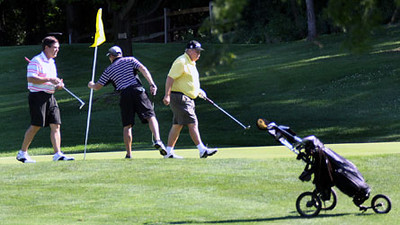 Jeff Krage – For the Kane County Chronicle<br /> Golfers leave the 8th green during Saturday's qualifying round of the St. Charles Men's Golf Tournament at Pottawatomie Golf Course.<br /> St. Charles 7/28/12