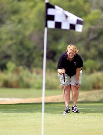 Katie Skubisz of St. Charles lines up her putt at Pottawatomie Golf Course for the St. Charles Women's Golf Tournament Tuesday morning.