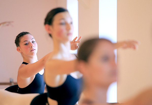 """Jessi Kennedy (far left), a dancer from Lifetime's """"Dance Moms: Miami,"""" rehearses at State Street Dance Studio in Geneva with the studio's ballet technique class, including dancers Emily Kosek and Colleen Nyland. Kennedy is preparing for a competition at Phesant Run Resort in St. Charles."""