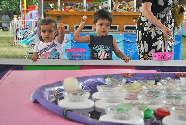 Sophia VanDeman (left), 2, and her brother Matthew, 4, of Villa Park, play a game Friday afternoon at the Sugar Grove Corn Boil. The festival runs through Sunday.