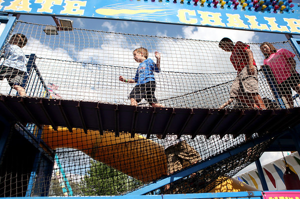 Children run through an obstacle course during opening day of the Sugar Grove Corn Boil Friday afternoon. The festival runs through Sunday.