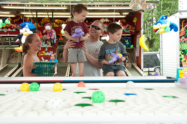 Aurora resident Cameron Ehrhart, 2, wins a prize at the Sugar Grove Corn Festival Sunday afternoon.