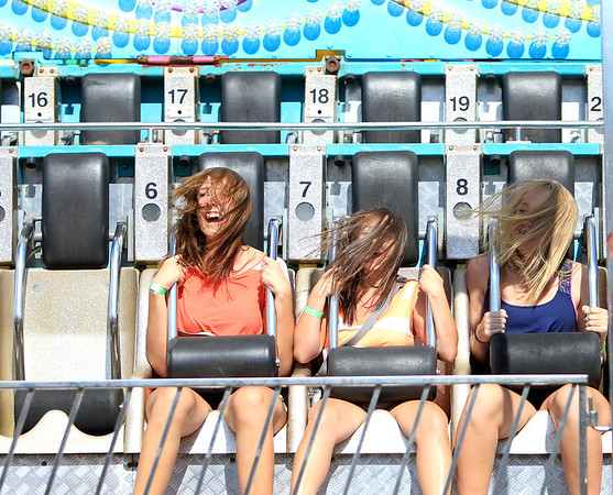 Emily Herriman, Jade Lara and Anna Wright, all 15, ride the 1001 Nachts during opening day of the Sugar Grove Corn Boil Friday afternoon. The festival runs through Sunday.